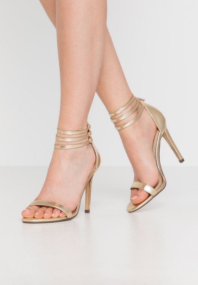 DEXTER - High heeled sandals - gold