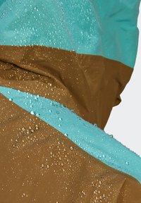 adidas Performance - XPLORIC RAIN JACKET - Hardshell jacket - wild moss/acid mint - 12