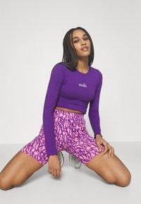 Ellesse - REO - Langærmede T-shirts - purple - 4