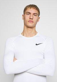 Nike Performance - Sports shirt - white/black - 3