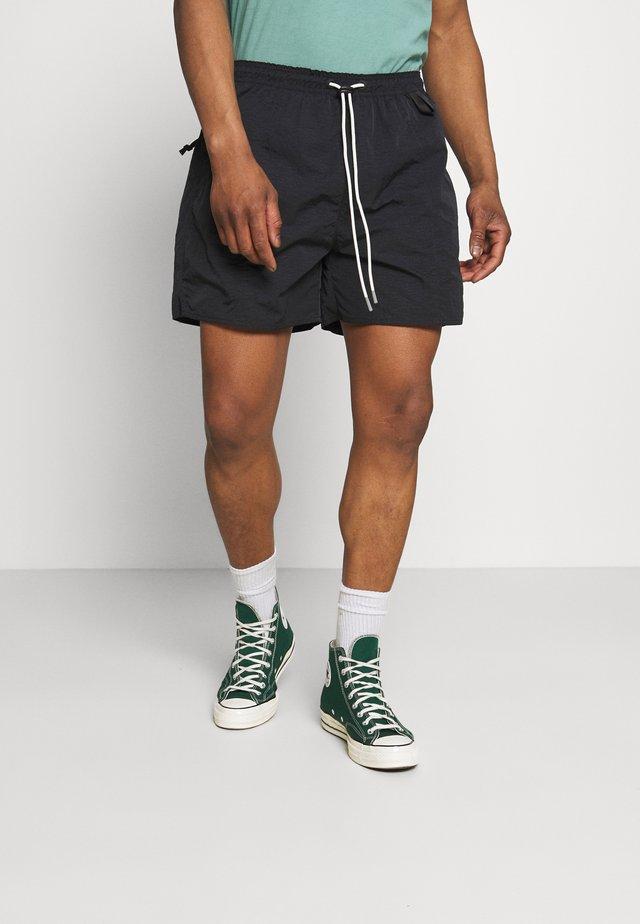 CUTTER UNISEX - Shorts - black