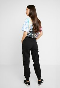ONLY - ONLBETSY ALVA PANT - Cargo trousers - black - 2