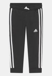 adidas Performance - UNISEX - Tracksuit bottoms - black/white - 0