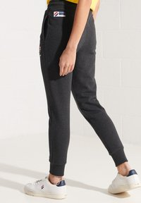 Superdry - Tracksuit bottoms - dark charcoal marl - 1