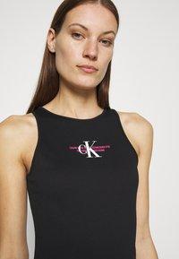 Calvin Klein Jeans - URBAN LOGO TANK DRESS - Sukienka z dżerseju - black - 3