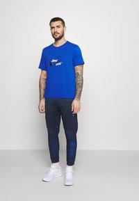 Nike Performance - ELITE PANT - Pantalon de survêtement - midnight navy/reflective silver - 1