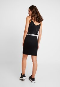 Tommy Jeans - TJW BODYCON SKIRT - Pencil skirt - tommy black - 2