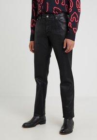 Just Cavalli - PANTS 5 POCKETS - Slim fit jeans - black - 0