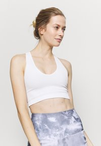 Free People - FREE THROW CROP - Light support sports bra - white - 3