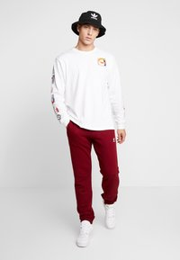 adidas Originals - TREFOIL PANT UNISEX - Tracksuit bottoms - collegiate burgundy - 1