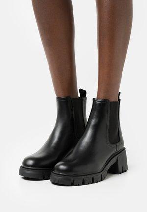VEGAN WIDE FIT KAIA COMBAT GUSSET BOOT - Platform ankle boots - black smooth