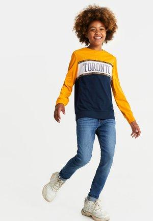 MET TAPEDETAIL - Slim fit jeans - blue
