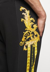 Versace Jeans Couture - Tracksuit bottoms - black - 3
