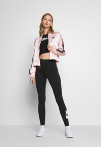 Nike Sportswear - LEGASEE FUTURA - Legging - black/white - 1