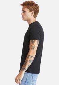 Timberland - SS DUNSTAN RIVER POCKET TEE - Basic T-shirt - black - 3