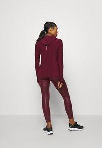Nike Performance - HOODIE RUNWAY - Sports shirt - dark beetroot - 2