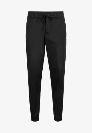 TAPERED CUFFED - Tracksuit bottoms - black