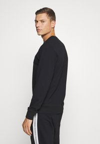 Diesel - UMLT-WILLY SWEAT-SHIRT - Pyjama top - black - 2