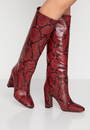High heeled boots - red