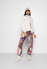 Weekday - CORINNA  - Tracksuit bottoms - sunset - 1
