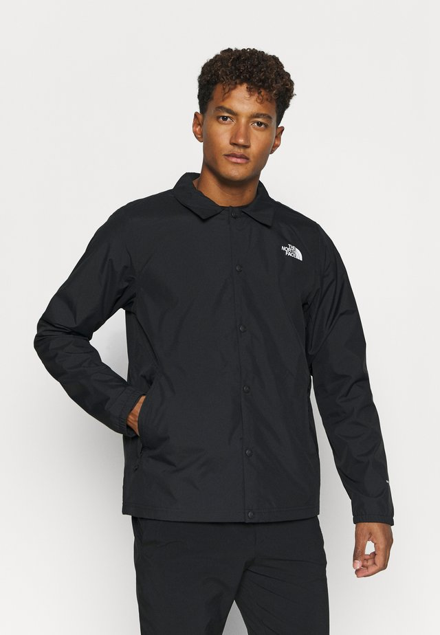 WALLS ARE MEANT FOR CLIMBING COACHE - Softshelljacke - black