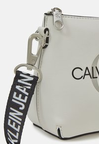 Calvin Klein Jeans - CAMERA POUCH - Across body bag - white - 4