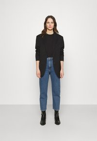 ARKET - Relaxed fit jeans - washed blue - 1