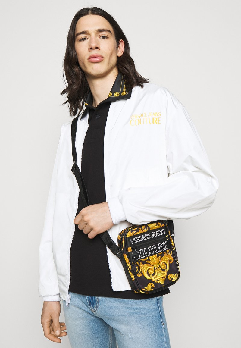Versace Jeans Couture - UNISEX - Across body bag - black/gold