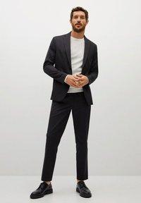 Mango - COOL - Trousers - schwarz - 1