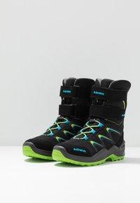 Lowa - MADDOX WARM GTX - Winter boots - black/lime - 3