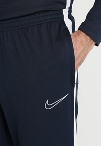 Nike Performance - DRY ACADEMY - Tracksuit bottoms - obsidian/white/white - 5