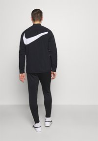 Nike Performance - PANT - Tracksuit bottoms - black/anthracite/white - 2