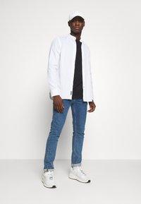 Calvin Klein - STAND COLLAR LIQUID TOUCH - Shirt - white - 1