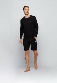 BOSS - HERITAGE - Shorts - black - 1