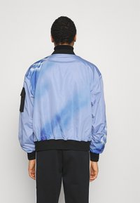 Blood Brother - COOMBE REVERSIBLE UNISEX - Bomber Jacket - black/blue - 2