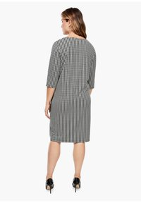 Triangle - Jersey dress - black houndstooth aop - 2