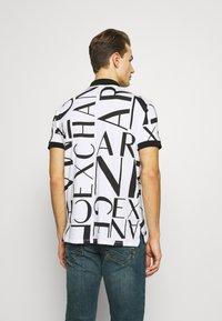 Armani Exchange - Koszulka polo - white/black - 2