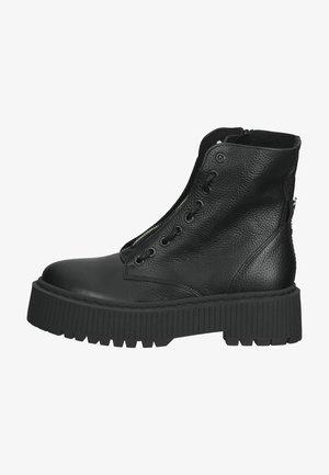 Bottines à plateau - black leather
