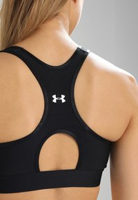 Under Armour - MID KEYHOLE BRA - Sujetador deportivo - black - 4