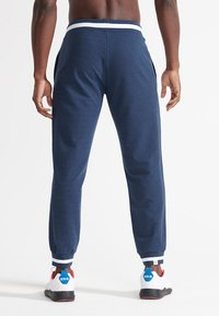 Superdry - Tracksuit bottoms - richest navy - 1