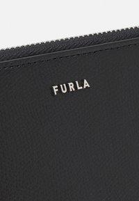 Furla - PROJECT ZIP AROUND ARE UNISEX - Peněženka - nero/ciliegia - 4