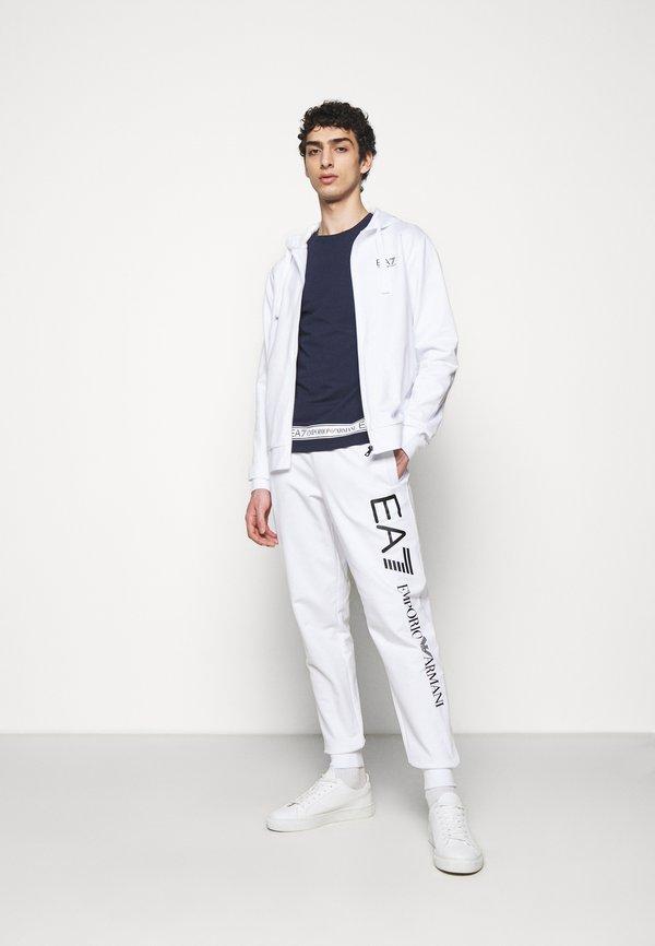 EA7 Emporio Armani Spodnie treningowe - white/black/biały Odzież Męska PJMQ