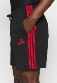 adidas Performance - Krótkie spodenki sportowe - black/scarlet - 5
