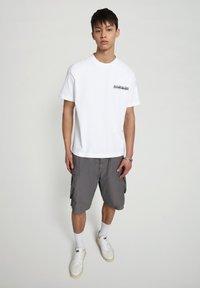 Napapijri - S JURASSIC - Print T-shirt - bright white - 1