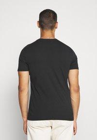 AllSaints - BADMANNA CREW - Print T-shirt - jet black/optic white - 2