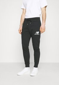 New Balance - ESSENTIAL STACK LOGO  - Spodnie treningowe - black - 0