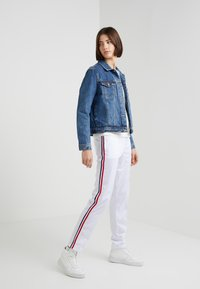 Rossignol - TRACKSUIT PANT - Bukse - white - 1