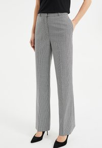 WE Fashion - Trousers - all-over print - 0