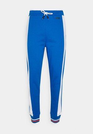 UMLB-PETER-SP - Tracksuit bottoms - blue