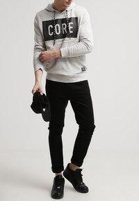 Nudie Jeans - LEAN DEAN - Slim fit jeans - dry cold black - 0